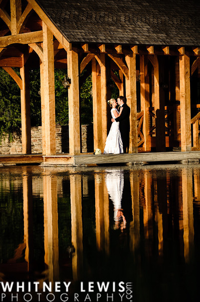 lake, wood beams, bridal couple, reflection