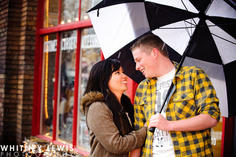 umbrella, smiling, snow falling, engagement photos