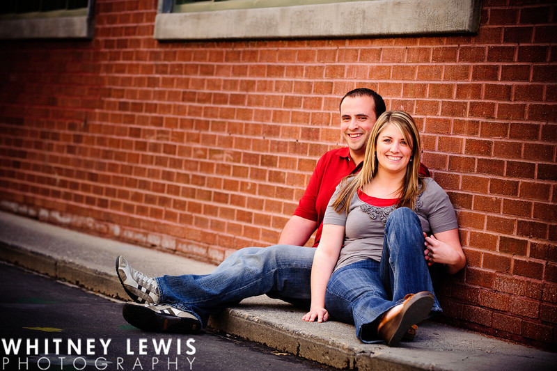 brick wall, red, relaxing, holding hands, salt lake city