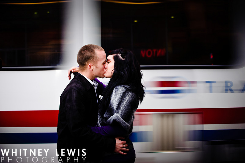 Kissing in front of Utah Trax car