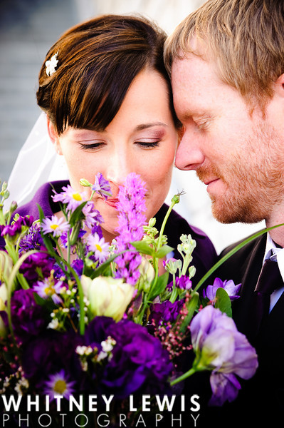 tender moment, bouquet, purple colors, bride and groom