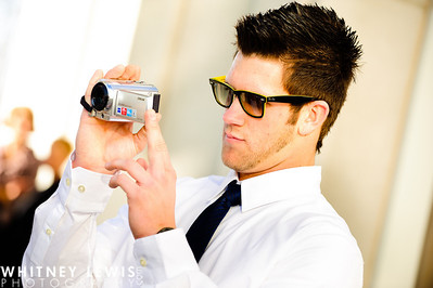 Bryce Harper with a video camera recording his sister's wedding